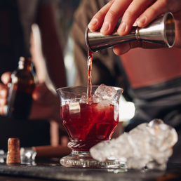 Pouring a Negroni Cocktail