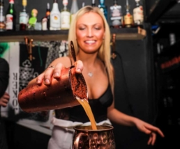 Mixologist Pouring a Cocktail